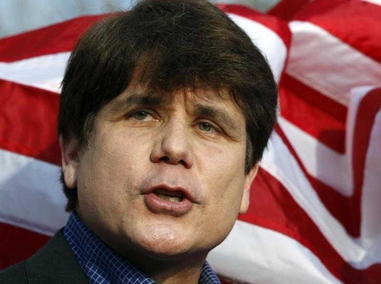 Former Illinois Governor Rod Blagojevich makes a statement to reporters outside his Chicago home one day before reporting to federal prison in Colorado to serve a 14-year sentence for corruption, in this March 14, 2012 file photo. REUTERS/Jeff Haynes