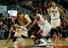 Mar 28, 2016; Chicago, IL, USA; Chicago Bulls guard Jimmy Butler (21) fouls Atlanta Hawks guard Kyle Korver (26) during the second half at United Center. Kamil Krzaczynski-USA TODAY Sports