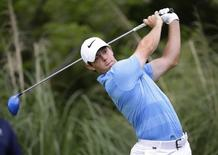 Mar 27, 2016; Austin, TX, USA; Rory McIlroy of Northern Ireland plays against Jason Day of Australia during round six of the World Golf Championship-Dell Match Play at the Austin Country Club. Mandatory Credit: Erich Schlegel-USA TODAY Sports -