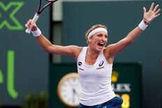 Mar 29, 2016; Key Biscayne, FL, USA; Timea Bacsinszky celebrates after match point against Simona Halep (not pictured) during day nine of the Miami Open at Crandon Park Tennis Center. Mandatory Credit: Geoff Burke-USA TODAY Sports