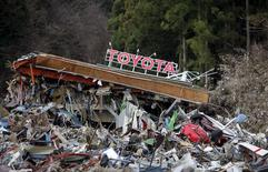 A Toyota dealership is seen at a devastated area after the earthquake and tsunami, in Minamisanriku town, Miyagi prefecture, March 22, 2011 file photo. REUTERS/Carlos Barria/Files