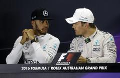 Formula One -  Australia Grand Prix - Melbourne, Australia - 20/03/16 -  Australian Formula One Grand Prix winner, Mercedes F1 driver Nico Rosberg (R) speaks with team mate Lewis Hamilton at the post-race press conference in Melbourne.   REUTERS/Brandon Malone
