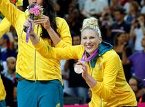 Australia's Lauren Jackson shows off her bronze medal during victory ceremony at the North Greenwich Arena during the London 2012 Olympic Games August 11, 2012.                     REUTERS/Mike Segar