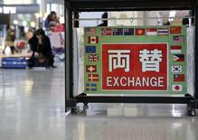 The word 'Echange' in Japanese surrounded with various national flags is seen at an exchage office at Narita International airport, near Tokyo, Japan, March 25, 2016. The dollar was on track on Friday for a weekly gain of over 1 percent against a basket of currencies after a chorus of U.S. Federal Reserve officials signalled more interest rate increases than the market had been pricing in. REUTERS/Yuya Shino