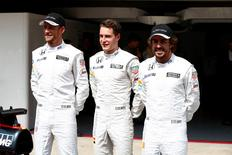 Formula One - F1 - Brazilian Grand Prix 2015 - Autodromo Jose Carlos Pace, Sao Paulo, Brazil - 12/11/15 McLaren's Fernando Alonso, Jenson Button and Stoffel Vandoorne pose ahead of the Brazilian Grand Prix Mandatory Credit: Action Images / Hoch Zwei Livepic