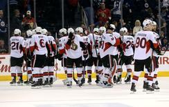 Mar 30, 2016; Winnipeg, Manitoba, CAN; Ottawa Senators celebrate their win over the Winnipeg Jets at MTS Centre. Ottawa Senators win 2-1. Mandatory Credit: Bruce Fedyck-USA TODAY Sports - RTSCX94
