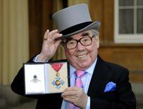 File photo of Ronnie Corbett posing for photographs after being presented with his Commander of the Order of the British Empire (CBE) medal by Queen Elizabeth during an investiture ceremony at Buckingham Palace in London February 16, 2012. REUTERS/Rebecca Naden/pool