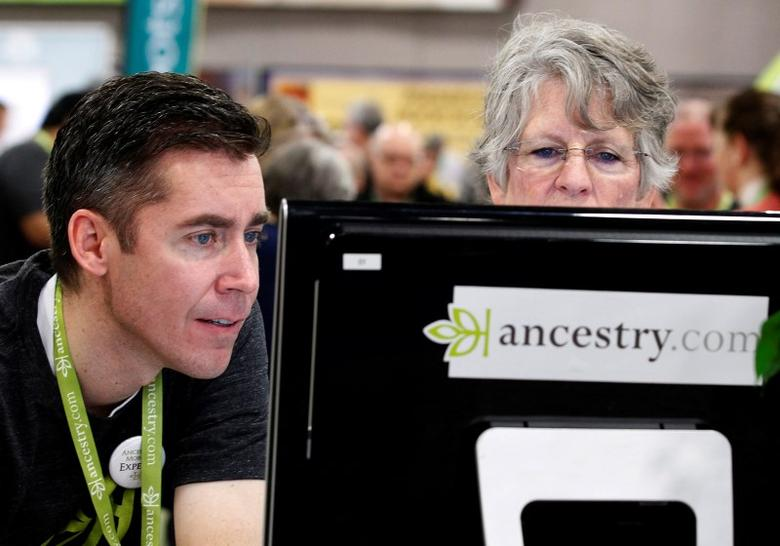 David Reese and Dana Gull, (R) try out software at the Ancestry.com booth at the Rootstech Conference, sponsored by Family Search, in Salt Lake City, Utah February 7, 2014. REUTERS/George Frey