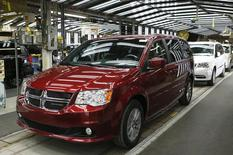 Fiat Chrysler's Dodge minivans move down the final production line at the Windsor Assembly Plant in Windsor, Ontario, February 9, 2015. REUTERS/Rebecca Cook