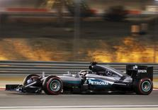 Mercedes F1 driver, Lewis Hamilton of Britain drives during qualifying session for Bahrain F1 GP. REUTERS/Hamad I Mohammed.