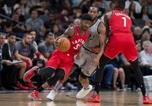 Apr 2, 2016; San Antonio, TX, USA; Toronto Raptors forward Terrence Ross (31) dribbles the ball around San Antonio Spurs forward Kawhi Leonard (2) during the second quarter at the AT&T Center. Mandatory Credit: Jerome Miron-USA TODAY Sports