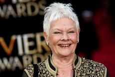 British actress Judi Dench poses for photographers as she arrives at the Olivier Awards at the Royal Opera House in London, Britain April 3, 2016. REUTERS/Neil Hall
