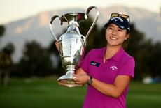 Apr 3, 2016; Rancho Mirage, CA, USA; Lydia Ko holds the Ana Inspiration trophy after she wins the ANA Inspiration tournament at Mission Hills CC - Dinah Shore Tournament Course.  Kelvin Kuo-USA TODAY Sports