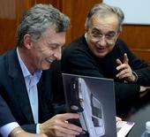 Argentina's President Mauricio Macri (L) looks at Fiat brochure next to Sergio Marchionne, CEO of Fiat Chrysler, during a visit to a Fiat plant near Cordoba, Argentina, April 5, 2016. REUTERS/Argentine Presidency/Handout via Reuters