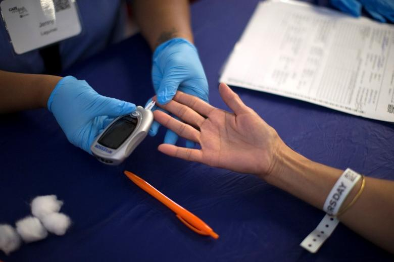 A person receives a test for diabetes during Care Harbor LA free medical clinic in Los Angeles, California September 11, 2014. REUTERS/Mario Anzuoni