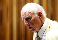 Former Grand Slam doubles champion Bob Hewitt look on ahead of court proceedings at the South Gauteng High Court in Johannesburg February 10, 2015.  REUTERS/Siphiwe Sibeko