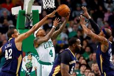 Apr 6, 2016; Boston, MA, USA; Boston Celtics guard Isaiah Thomas (4) goes to the basket between New Orleans Pelicans center Alexis Ajinca (42), center Kendrick Perkins (5) and forward Dante Cunningham (44) during the first half at TD Garden. Winslow Townson-USA TODAY Sports
