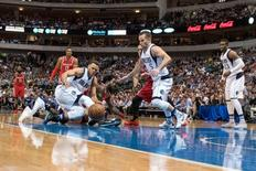Apr 6, 2016; Dallas, TX, USA; The Dallas Mavericks and Houston Rockets fight for the loose ball during the second half at the American Airlines Center. Jerome Miron-USA TODAY Sports