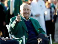 Apr 7, 2016; Augusta, GA, USA; Honorary starter Arnold Palmer gives a thumbs up as he is seated along the first tee during the first round of the 2016 The Masters golf tournament at Augusta National Golf Club. Mandatory Credit: Rob Schumacher-USA TODAY Sports