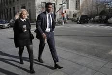 New York Jets wide receiver and television host Brandon Marshall arrives for a civil trial, with his wife Michi Nogami, at the Manhattan Federal Courthouse in New York April 5, 2016. REUTERS/Brendan McDermid