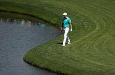 Apr 7, 2016; Augusta, GA, USA; Jordan Spieth walks along the water on the 15th hole during the first round of the 2016 The Masters golf tournament at Augusta National Golf Club. Mandatory Credit: Rob Schumacher-USA TODAY Sports