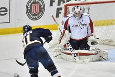 Apr 9, 2016; St. Louis, MO, USA; Washington Capitals goalie Braden Holtby (70) makes a save on a shot taken by St. Louis Blues right wing Vladimir Tarasenko (91) during the third period at Scottrade Center. The Washington Capitals defeat the St. Louis Blues 5-1. Mandatory Credit: Jasen Vinlove-USA TODAY Sports