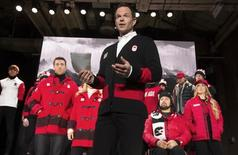 Jean-Luc Brassard speaks during the unveiling of the Canadian Olympic and Paralympic team clothing in Toronto, October 30, 2013.    REUTERS/Mark Blinch