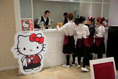 Employees prepare food for customers in China's first official Hello Kitty-themed restaurant in Shanghai.   REUTERSAly Song