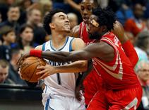 Apr 11, 2016; Minneapolis, MN, USA; Houston Rockets guard Patrick Beverley (2) tries to wrestle the ball away from Minnesota Timberwolves guard Tyus Jones (1) in the second quarter at Target Center. Bruce Kluckhohn-USA TODAY Sports