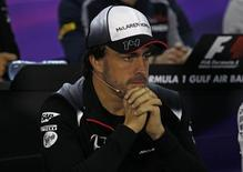 Formula One - Bahrain Grand Prix - Sakhir, Bahrain - 31/03/16 - McLaren Honda Formula One driver, Fernando Alonso of Spain, listens to a journalist during the drivers press conference ahead of the Bahrain F1 Grand Prix. REUTERS/Hamad I Mohammed