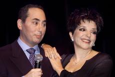 U.S. singer Liza Minnelli and producer David Gest speak at a newsconference at the House of Blues in Beverly Hills, California, in this file photo taken July 25, 2002.   REUTERS/Robert Galbraith/Files