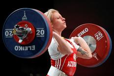 Boyanka Kostova of Azerbaijan competes in the women's 53kg weightlifting competition during the World Weightlifting Championships at Disney Village in Marne-la-Vallee outside Paris November 6, 2011. REUTERS/Benoit Tessier