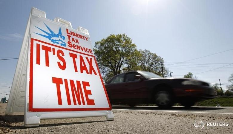 File photo of a car passing a sign advertising tax return services in Falls Church, Virginia April 8, 2010. REUTERS/Kevin Lamarque