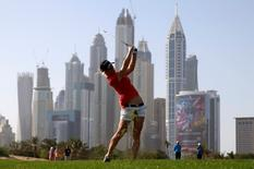 Melissa Reid of England hits the ball at the 13th hole during the third round of the Dubai Ladies Masters golf tournament in Dubai, United Arab Emirates, December 11, 2015. REUTERS/Ahmed Jadallah