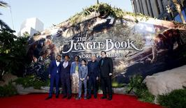 "Director of the movie Jon Favreau (R) poses with cast members (L-R) Ritesh Rajan, Giancarlo Esposito, Lupita Nyong'o, Neel Sethi and Ben Kingsley at the premiere of ""The Jungle Book"" at El Capitan theatre in Hollywood, California April 4, 2016. REUTERS/Mario Anzuoni"