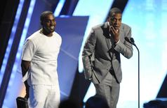 "Kanye West and Jay-Z (R) accept the award for best group at the 2012 BET Awards in Los Angeles, July 1, 2012. A Kanye West fan sued the rapper and Jay Z's Tidal on April 18, 2016, claiming they tricked people into subscribing to the music streaming service by fraudulently claiming it was the only way to buy West's album ""The Life of Pablo.""  REUTERS/Phil McCarten/File Photo"