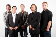 "Members of the band Pearl Jam (L-R), Stone Gossard, Mike McCready, Matt Cameron, Eddie Vedder, and Jeff Ament of the film ""Pearl Jam Twenty"" pose during the 36th Toronto International Film Festival (TIFF) in Toronto, September 10, 2011. REUTERS/Mark Blinch"