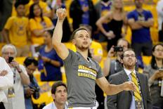 Golden State Warriors guard Stephen Curry (30) follows through on a shot attempt during warm ups before the start of the game against the Houston Rockets in game two of the first round of the NBA Playoffs at Oracle Arena. Mandatory Credit: Cary Edmondson-USA TODAY Sports