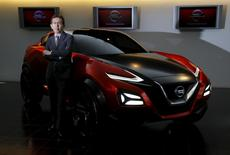 Shiro Nakamura, Senior Vice President and Chief Creative Officer of Nissan Motor Co, poses for a photo with Nissan Gripz concept car at the company's Global Design Center in Atsugi, Japan, April 14, 2016. REUTERS/Toru Hanai