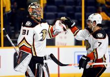 Anaheim Ducks goalie Frederik Andersen (31) is congratulated by center Andrew Cogliano (7) after a win against the Nashville Predators in game three of the first round of the 2016 Stanley Cup Playoffs at Bridgestone Arena. The Ducks won 3-0. Mandatory Credit: Christopher Hanewinckel-USA TODAY Sports