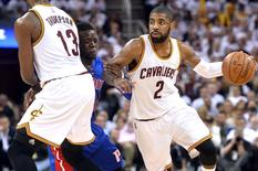 Cleveland Cavaliers guard Kyrie Irving (2) drives against center Tristan Thompson (13) as Detroit Pistons guard Reggie Jackson (1)  defends during the third quarter in game two of the first round of the NBA Playoffs at Quicken Loans Arena. Mandatory Credit: Ken Blaze-USA TODAY Sports