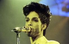 Prince performs during his 'Diamonds and Pearls Tour' at the Earl's Court Arena in London, Britain, June 15, 1992.   REUTERS/Dylan Martinez