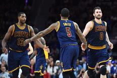 Apr 22, 2016; Auburn Hills, MI, USA; Cleveland Cavaliers guard J.R. Smith (5) high fives forward Kevin Love (0) and center Tristan Thompson (13) during the fourth quarter against the Detroit Pistons in game three of the first round of the NBA Playoffs at The Palace of Auburn Hills. Mandatory Credit: Tim Fuller-USA TODAY Sports