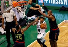 Apr 22, 2016; Boston, MA, USA; Boston Celtics guard Isaiah Thomas (4) works the ball against Atlanta Hawks center Al Horford (15) and forward Kent Bazemore (24) during the fourth quarter in game three of the first round of the NBA Playoffs at TD Garden. Mandatory Credit: David Butler II-USA TODAY Sports