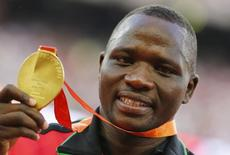 Julius Yego of Kenya presents his gold medal as he poses on the podium after the men's javelin throw event during the 15th IAAF World Championships at the National Stadium in Beijing, China, August 27, 2015. REUTERS/Damir Sagolj