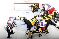 Apr 23, 2016; Pittsburgh, PA, USA; Pittsburgh Penguins goalie Matt Murray (30) makes a save against the New York Rangers as players crash the net during the second period in game five of the first round of the 2016 Stanley Cup Playoffs at the CONSOL Energy Center. Charles LeClaire-USA TODAY Sports - RTX2BDCL