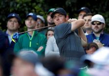 Apr 7, 2016; Augusta, GA, USA; Rory McIlroy hits his tee shot on the 14th hole during the first round of the 2016 The Masters golf tournament at Augusta National Golf Club. Mandatory Credit: Rob Schumacher-USA TODAY Sports