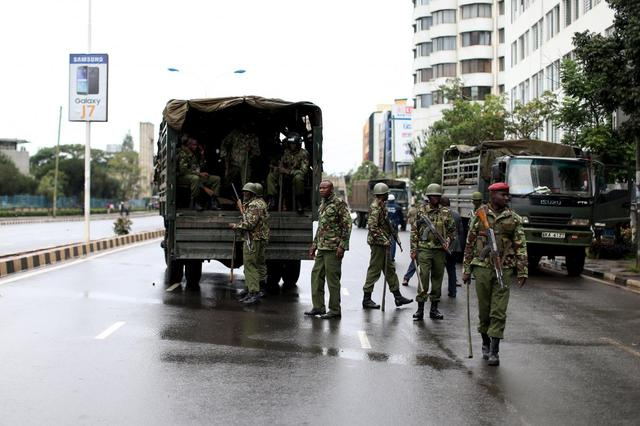 Kenyan police guard a street after dispersing a crowd consisting of opposition leaders and their supporters after they tried to enter the premises of the the office of the country's electoral commission to demand its disbandment ahead of next year's election in Nairobi, Kenya, April 25, 2016. REUTERS/Siegfried Modola