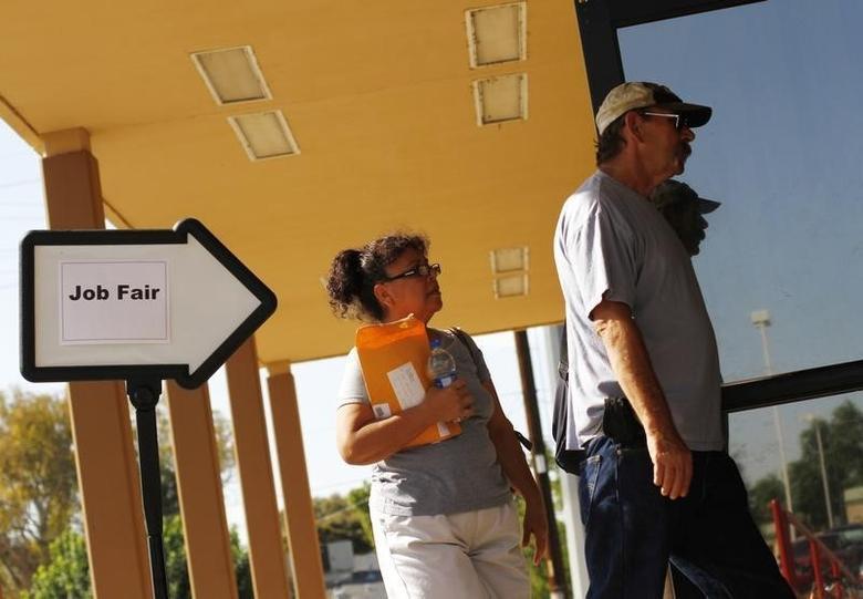 A man and woman enter a job fair at the Phoenix Workforce Connection in Phoenix, Arizona August 30, 2011. REUTERS/Joshua Lott