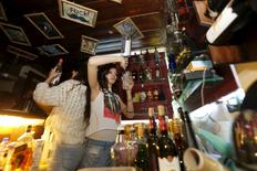 A bartender pours a drink at 80s Bar in Damascus, Syria, March 11, 2016. I REUTERS/Omar Sanadiki